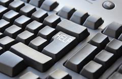 Grey keyboard with word help on enter Stock Photos