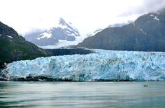 alaskan glacier and boat right - stock photo