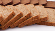 Stock Video Footage of Sliced fresh bread isolated on white