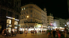 Tourists walk at night in center of Vienna, Austria Stock Footage