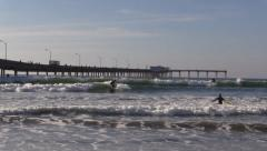 Surfers Next To Ocean Beach Pier 02 - stock footage