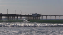 Surfers Next To Ocean Beach Pier 03 - stock footage