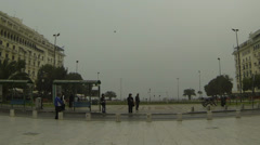 Aristotelous square, Thessaloniki Greece. People walking and flock of birds. Stock Footage