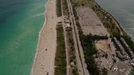 Stock Video Footage of Wide aerial shot following Collins Avenue running parallel to the beach, tilt up