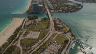 Stock Video Footage of Wide birdseye aerial shot of Collins Avenue and Haulover Beach Park, tilt up