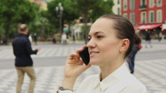 Close up portrait of young businesswoman talking on smart phone outdoors HD - stock footage