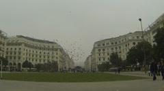 Aristotelous square, Thessaloniki Greece. People walking,flock of birds Stock Footage