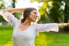 Woman feeling freedom at sunset Stock Photos