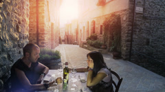 Friends having a dinner in old italian borgo Stock Footage