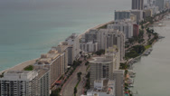 Stock Video Footage of Wide aerial shot following Collins Avenue through Miami Beach, revealing the