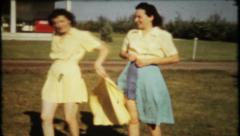 690 - ladies make  fashion statement with new dresses - vintage film home movie Stock Footage