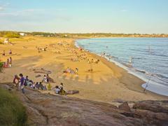 Crowded enjoying summer at the beach Stock Photos
