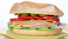 Sandwich with sliced turkey, swiss cheese and tomato Stock Footage