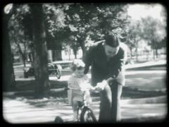 Girl Learning to Ride Bike Stock Footage
