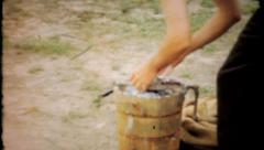 696 - ice cream maker in use at family picnic - vintage film home movie - stock footage