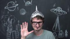 Stock Video Footage of Strange man with tinfoil helmet on