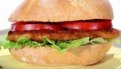 Chicken cutlet and tomato sandwich Stock Footage
