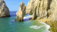 Stock Video Footage of Cabo aerial flight through the arch at lands end - ext version approach and exit