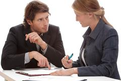 Businessman persuading to signing a contract Stock Photos