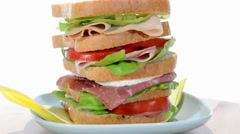 Tall sandwich with ham, chicken, cheese and tomato Stock Footage