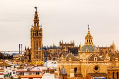 giralda bell tower cathedral of saint mary of the see spire church of el salv - stock photo