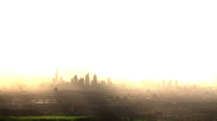 Stock Video Footage of Aerial view of the London skyline on a hazy autumn morning.
