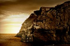 sepia tinted cliff ruins - stock photo