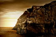 Stock Photo of sepia tinted cliff ruins