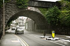 european hill road under arch - stock photo