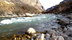 Fast, clean, mountain river flowing among stones Stock Footage