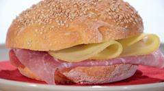 Sesame seed bread with ham and cheese Stock Footage