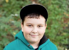 young boy in a baseball cap - stock photo