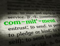 Dictionary - Commitment - Green On BG - stock photo