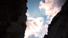 Beautiful clouds between canyon Stock Footage