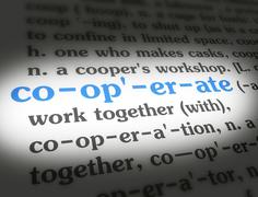 Dictionary - Cooperate - Blue On White Stock Photos