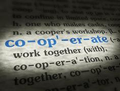 Dictionary - Cooperate - Blue On BG Stock Photos