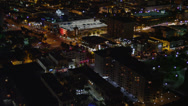 Stock Video Footage of Wide aerial shot of cafes and shops on the intersection of Collins Avenue and