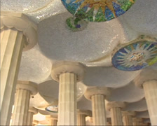 Mosaic tiled medallions, ceiling and doric columns  pan + hold Parc Guell Stock Footage