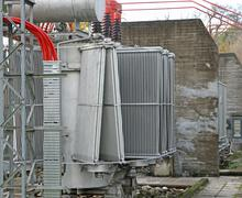 Electric voltage transformer of a powerful power plant Stock Photos