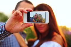 Couple taking self-portrait  photos with mobile smart phone Stock Photos