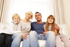 Portrait of happy family at home Stock Photos