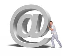 businessman pushing email symbol - stock photo