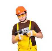builder holding drill - stock photo