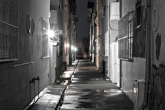 dark back alley on a wet night - stock photo