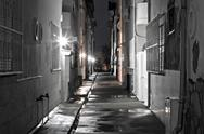 Stock Photo of dark back alley on a wet night