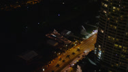 Stock Video Footage of Wide aerial shot half orbit of a yacht docked by Collins Avenue on Indian Creek,