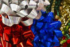 blue, red and silver christmas bows - stock photo