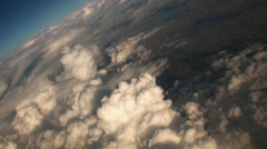 Enchantement clouds from aeroplane window seat view in flight Stock Footage