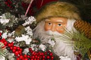Stock Photo of santa looking out from a wreath
