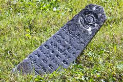 fallen headstone - stock photo